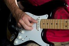 Picking  on electric guitar black & white Stock Photo