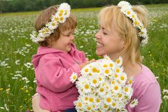 Picking flowers with mom Royalty Free Stock Images
