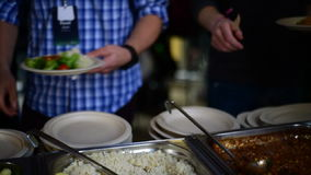 Picking food from  buffet at the conference stock video footage