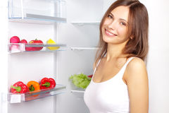 Picking food from fridge stock image
