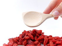 Picking Goji Berries with Spoon Royalty Free Stock Images