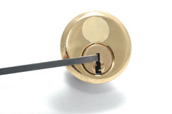 Picking a lock. Picking a pin-tumbler lock with a tension wrench Royalty Free Stock Photos