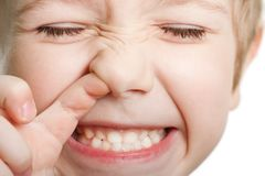 Picking nose. Fun looking eye cute human child face Stock Photography