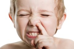 Picking nose. Fun looking eye cute human child face Stock Image