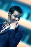 Picking Nose 3. A young man dressed in stylish clothes picks his nose while looking to the side Royalty Free Stock Photo