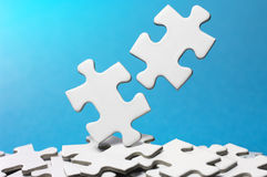 Picking out two puzzle pieces.(horizontal) Stock Photo