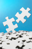 Picking out two puzzle pieces.(vertical) Stock Images