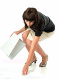 Picking papers. Young female secretary picking up lost papers Royalty Free Stock Photography