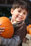 Picking Pumpkins Royalty Free Stock Photos