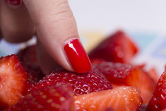 Picking red strawberries Stock Images