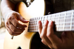 Picking style playing guitar right hand. Man playing a guitar picking style with right hand Stock Image