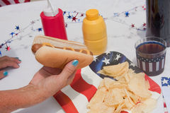Picking Up A 4th Of July Hotdog Royalty Free Stock Photography