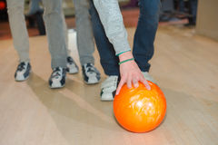 Picking up bowling ball Stock Photos