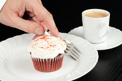 Picking Up Fork To Eat Red Velvet Cupcake with Espresso Stock Photos