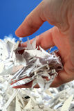 Picking up Litter 2. Hand holding shredded paper Stock Image