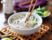 Picking up noodles out of a bowl of pho Stock Photos