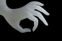Picking up, OK hand shape resin ring display holder for jewelry display on dark background use for advertising design for jewelry. Shop or nail salon Stock Image