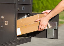 Picking up packages at the mailbox royalty free stock photos