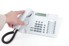 Picking up the phone Royalty Free Stock Image