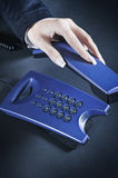 Picking up the phone Stock Image