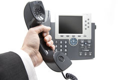 Picking up the phone Royalty Free Stock Images