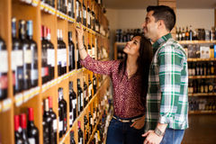 Picking up some wine at the store Stock Photos