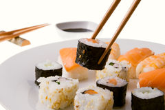 Picking up a sushi roll Royalty Free Stock Photo