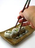 Picking up sushi on white Royalty Free Stock Image