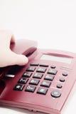 Picking up telephone Stock Image