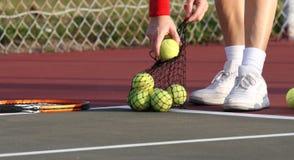Picking up Tennis Balls. After playing tennis Stock Photos