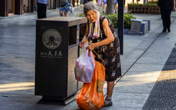 Picking up waste for the elderly Royalty Free Stock Photos