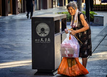 Picking up waste for the elderly Stock Image