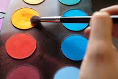 Picking the yellow from eyeshadow palette Royalty Free Stock Photos