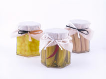 Pickle. In jars - cucumber, onion and corn-cons isolated Royalty Free Stock Photos