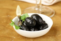 Pickle black olives in a bowl Stock Images