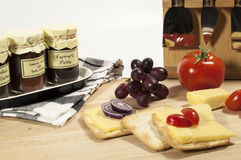 Pickle,cheese and cracker display Stock Images