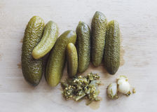 Pickle with herbs and garlic on wooden background Stock Photography