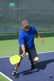 Pickleball Action - Man in Blue Hitting Forehand Near Sideline Stock Images