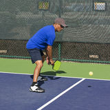 Pickleball Action - Man in Blue Preparing to Hit A Backhand Dink Stock Images