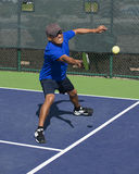 Pickleball Action - Man Wearing Blue Gritting Teeth While Stretching To Hit Forehand Shot Stock Photo