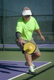Pickleball Action - Senior Male Player Hitting Backhand Stock Photography