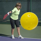 Pickleball Action - Senior Woman Hitting Backhand Stock Photo