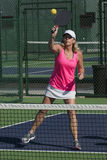 Pickleball - Female Hitting Ball At Net Royalty Free Stock Image