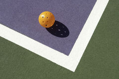 Pickleball Laying on Edge of Court Royalty Free Stock Photography
