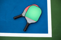 Pickleball paddle and ball Stock Photo