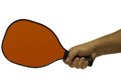 Pickleball Paddle with Hand. Simple image of a red pickleball paddle being held (by a man stock images