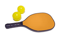 Pickleball Paddle and Two Balls. Simple isolated image of a pickleball paddle and two pickleballs.  Clipping mask for paddle face is included so you can change Stock Images