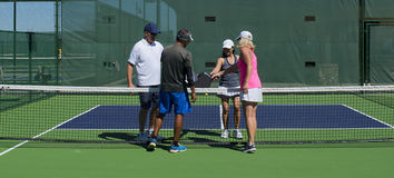 Pickleball - Two Couples Congratulating Each Other After A Game Well Played Royalty Free Stock Photos