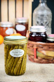 Pickled Beans. Home made pickled beans among several jars of preserves in vertical format Stock Image