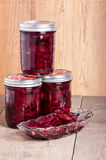 Pickled beets in jars and bowl Royalty Free Stock Image